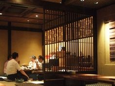 a lot of izakaya' have a private room divided by slats or thin walls - leave your shoes at the genkan in a small box like locker http://www.tokyotopia.com/image-files/en-izakaya-interior.jpg