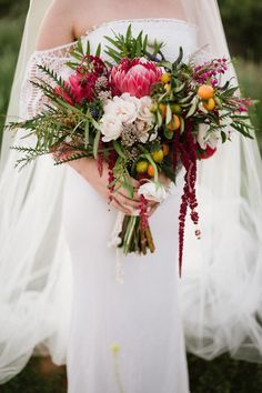Protea and peony bridal bouquet | 100 Layer Cake