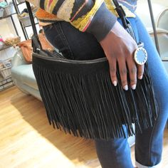 Carry this trendy suede fringe bag $79 over the shoulder or cross-body. Also in light brown.