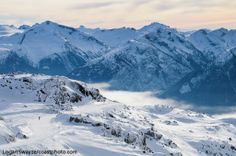 The view from the top of Whistler mountain in the Pacific Coast mountains of BC, Canada. Whistler Blackcomb resort is now fully open and celebrating the holidays!