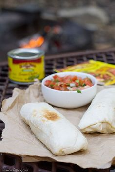 Make Ahead Breakfast Burritos - perfect camping food! Forget the bagels and the cereal - you can have a hot breakfast even when mornings are crazy when you are camping with these make-ahead breakfast burritos! Campfire Breakfast Burritos, Camping Breakfast, Breakfast Recipes, Ham Breakfast, Camping Coffee, Breakfast Ideas, Homestead Survival, Camping Illustration, Camping Food Make Ahead