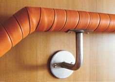 Lovely Leather-wrapped handrail -- think about doing this with old belts!
