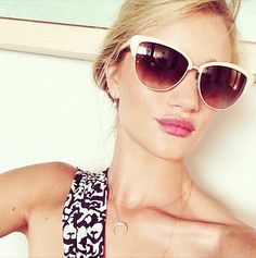 Rosie Huntington-Whitely is stunning in white cat-eye sunglasses and a dainty necklaces