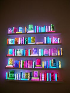 Light 'em up.  Adding coloured LED lights to the shelves would not be exactly like this but it would add a bright, colourful touch.