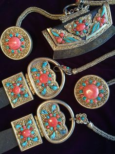 A set of men's gilt silver belt pendants, toggles and tinder pouch with flint striker. Mongolia, 19th c. Inset turquoise and coral.