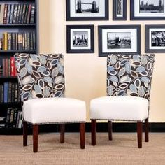 @Overstock - The Duet Emma armless chair is part of the Portfolio Home Collection and features an upholstery in a combination of a printed fabric and cream renu leather. Sold as a set of 2, these chairs are perfect for the living or dining room.http://www.overstock.com/Home-Garden/Portfolio-Duet-Emma-Brown-Modern-Leaf-and-Cream-Renu-Leather-Armless-Chair-Set-of-2/6185161/product.html?CID=214117 $289.99