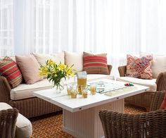 Relaxed wicker furniture gives this airy screen porch classic style. See the rest of this family-friendly home: http://www.bhg.com/home-improvement/remodeling/before-and-after/farmhouse-renovation/?socsrc=bhgpin051913airyscreenporch=10
