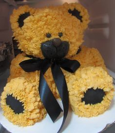 Leukemia Bear - Homemade vanilla cake with buttercream frosting and fondant detail. I made this cake for a little boys fundraiser. He has leukemia. Orange represents the fight for childhood cancer. So that is why I made the bear orange )