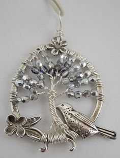 Hey, I found this really awesome Etsy listing at https://www.etsy.com/listing/233591566/beaded-tree-of-life-pendant-wire-wrapped