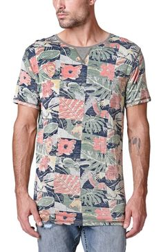 A PacSun.com Online Exclusive! PacSun presents the Critical Slide Society Rumble T-Shirt for men. This colorful men's t-shirt comes with a floral print throughout and a soft, comfortable feel.	Allover multi color print tee	Critical Slide Society logo loop on bottom	Crew neck	Short sleeves	Regular fit	Machine washable	100% rayon	Imported