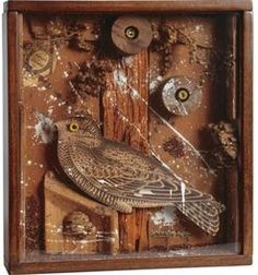 Joseph Cornell mixed media sculpture, Bird in a Box, wood, cork, branches, paint, printed paper and grains in wood and glass box construction