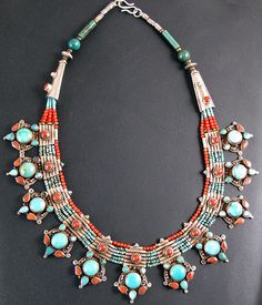 Turquoise & coral fine necklace. Finely worked Necklace made from silver with coral and turquoise.   Handcrafted in Nepal using traditional Tibetan designs.
