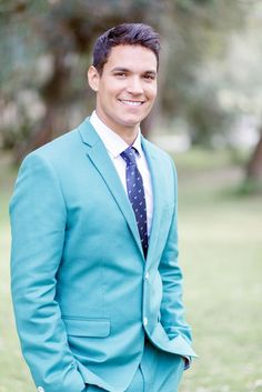 groom in a teal suit / Brian LaBrada Photography