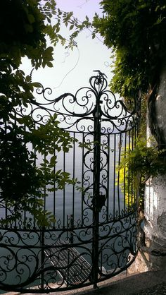 Beautiful gate looking over Lake Varenna, Province of Lecco, Lombardy, Italy Door Gate, Fence Gate, Garden Gates And Fencing, Comer See, The Secret Garden, Wrought Iron Gates, Iron Work, Entrance Gates, Gate Design