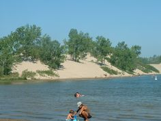 The Outlet and Dunes Beach at Sandbanks Provincial Park in Ontario have sandy lake bottoms, massive dunes and wide stretches of beach. Cool Countries, Countries Of The World, Ontario Beaches, O Canada, The Great White, The Dunes, Places Ive Been, Serenity, Swimming