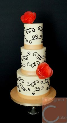 Happy Wedding Day! Traditional design Ivory/Champagne American buttercream iced 3/5/7 raspberry swirl cakes torted with buttercream. Hand piped traditional scroll work adorned with wafer paper floral, fondant ribbon.