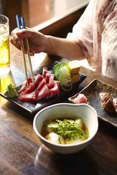 Tuna sashimi served with sea grape and wasabi at Hitoshi restaurant; tuna is high in protein and low in calories, and is one of the most popular ingredients in Okinawan cuisine ©Matt Munro / Lonely Planet