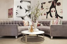 Love his space with large portrait art and wraparound couch