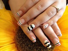 Acrylic nails with black and white nail art