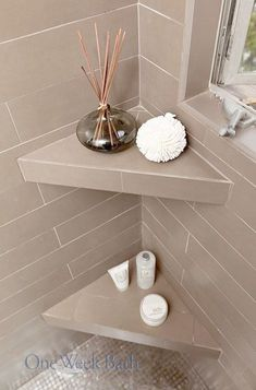 Insane STORAGE TIP: Corner shelving in your shower can be useful for placing shampoos, soaps, scrubs, and even diffusers. When installed at the right height, built-in shower shelving can provid . Shower Corner Shelf, Corner Toilet, Shower Shelves, Bathroom Shelves, Bathroom Storage, Bathroom Mirrors, Bathroom Cabinets, Bathroom Ideas, Bathroom Faucets