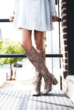 Newcastle Tall Boot   Free People Textured leather tall boots featuring a rounded toe and a block heel.