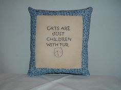 "The cat lover will warm to this message. It is hand-embroidered on muslin and trimmed in calico. It measures 8"" x 10""."