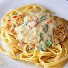 Tuscan Garlic Chicken - If you have a craving for tender chicken, hearty pasta and an unbelievably tasty creamy Parmesan sauce, this is the meal for you