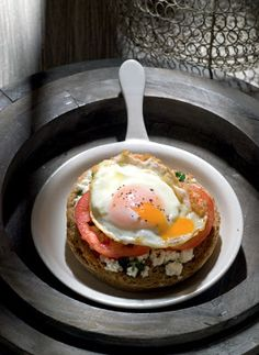 """""""Dakos"""" (barley rusk) with tomato and cheese, topped with fried egg"""