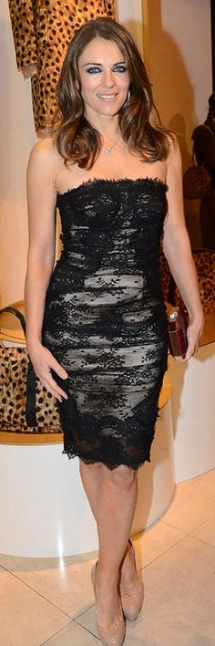 Who made  Elizabeth Hurley's nude platform pumps and black scallop lace strapless dress that she wore in London?