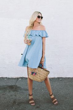Denim Ruffle Dress, a woven tote, and leather sandals
