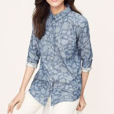 Loft Chambray Floral Buttondown NWT 5-star item! Meet the softened shirt – a light and airy button-down, with no detail left unbuttoned. Blooming with shadowed florals, this washed chambray button down flaunts a relaxed fit and a super-soft feel. Collared. Long sleeves. Patch chest pockets. Button front. Button cuffs. Back yoke with shirred detail. Shirttail hem. *No trades / No PP / 15% off bundles* LOFT Tops