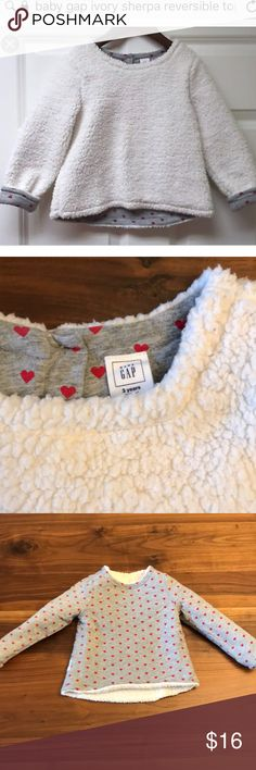 Baby GAP ivory Sherpa Reversible Top 3T Never worn Baby GAP ivory Sherpa top. Reversible to gray heather with hearts. Cotton and polyester. Machine washable. Size 3T.   Perfect condition. Absolutely adorable but my girls never got to wear it. GAP Shirts & Tops Sweatshirts & Hoodies