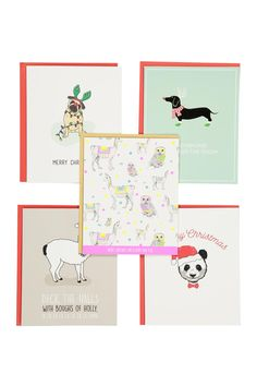 """We've picked a selection of our favourite Christmas cards so all of your friends and family can receive a card with the Typo twist. 5 designs, 10 Cards in total per pack. <br> Blank Inside. Envelopes included. <br> Dimensions: 13.5cm x 16.5cm/ 5.31"""" x 6.49"""". <br/>"""