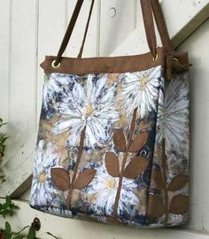Hand painted on fabric.  Suede leaves have been collaged over painting.  Lovely