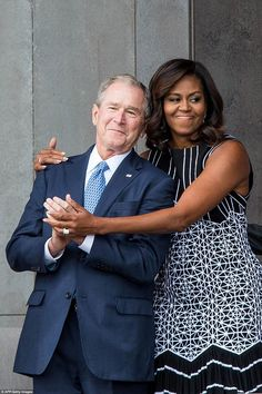 First Lady Michelle Obama and Former President George W Bush shared a sweet embrace at the...