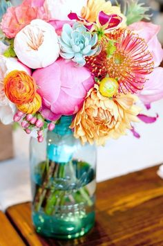 Tinted mason jars are perfect for small floral centerpieces