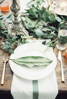 Use calligraphed leaves as table cards | Brides.com