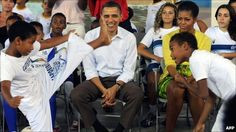 President Obama and Michelle Obama treated to a capoeira display during their visit to the 'City of God' in 2011 when visiting Brazil.....