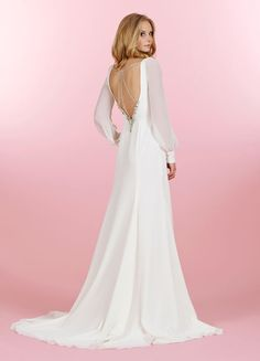 Style 1456 > Bridal Gowns, Wedding Dresses > Blush by Hayley Paige > Shown Ivory Chiffon long sleeve Wrap gown with Crystal accented Cuffs. Dramatic deep V-back with elaborate Turquoise & Rhinestone detail (back)