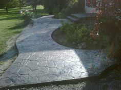 Stamped Concrete walkway.. We just We just did our patio and in front of my green house.. Salmon color stamped.. awesome