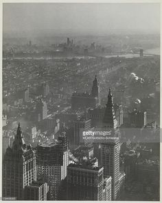 View facing Southeast from the Empire State Building. An unknown building is under construction in the foreground. The tower and clock of the Metropolitan Life Insurance Co. building on Madison Square, the East River, the Brooklyn and Manhattan Bridges Metropolitan Life Insurance Company Tower (New York, N.Y.) | Brooklyn Bridge (New York, N.Y.) | Manhattan Bridge