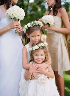 White flower girl dresses and floral hair accessories - wedding photo by Meg Smith Photography