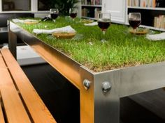 """Life-Altering Picnic Table of the Day: Bring the outdoors inside with The picNYC Table from Haiko Cornelissen Architecten.    """"Suddenly, spilling water becomes a necessity instead of a problem and wine glasses need coasters not to prevent ring stains but to avoid tumbling,"""" say the table's designers."""