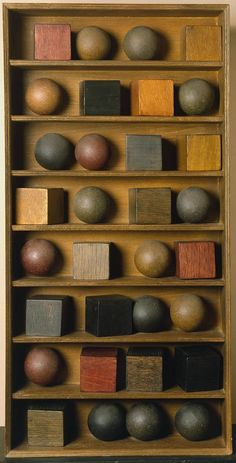 Pol Bury: 16 Balls and 16 Cubes on 7 Shelves (1966).