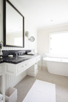 freestanding tub, penny-tile floors in a bathroom, soapstone countertop