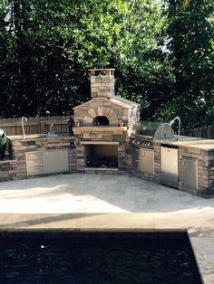 outdoor kitchen with a wood fired pizza oven