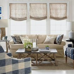 Farmhouse windows are trimmed in a variety of ways, from soft sheers to rustic burlap. The colors are primarily white and beige, with gray and plaid accents. Any of these farmhouse windows would look great in your home and will… Continue Reading → Coastal Living Rooms, Home Living Room, Living Room Decor, Blinds For Windows Living Rooms, Sunroom Windows, Bay Windows, Farmhouse Window Treatments, Burlap Window Treatments, Br House