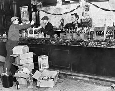 Federal officers confiscate liquor during a raid at an establishment on West Adams Street, December 1931.