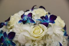 Bridal bouquet - blue orchids, white roses, white hydrangea. Simple, elegant, stunning. Wedding