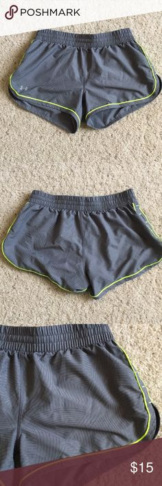 Under Armour Running Shorts Sz XS Gray running shorts with neon trim. Has built in liner and drawstring waist. Good condition. No trades or PayPal. Under Armour Shorts